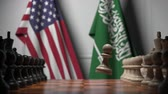 leider : Chess game against flags of USA and Saudi Arabia. Political competition related 3D animation Stockvideo