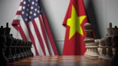 leider : Flags of the USA and Vietnam behind pawns on the chessboard. Chess game or political rivalry related 3D animation Stockvideo