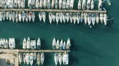 stožár : Aerial top down view of many docked sailing yachts in marina