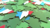 karton : Details of flag of Luxembourg on the cardboard Christmas trees. Winter holidays related 3D animation Stock mozgókép