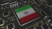 mikroprocesszor : National flag of Iran on the operating chipset. Iranian information technology or hardware development related conceptual 3D animation