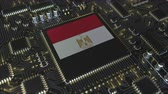 mikroprocesszor : National flag of Egypt on the operating chipset. Egyptian information technology or hardware development related conceptual 3D animation Stock mozgókép