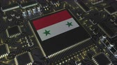 mikroprocesszor : National flag of Syria on the operating chipset. Syrian information technology or hardware development related conceptual 3D animation Stock mozgókép