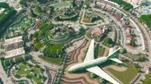 castello : DUBAI, UNITED ARAB EMIRATES - DECEMBER 31, 2019. Aerial down view of the Dubai Miracle Garden with Airbus A380 airliner flower structure Filmati Stock