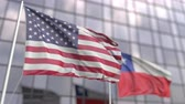 sdružení : Waving flags of the United States and Chile in front of a modern skyscraper facade Dostupné videozáznamy