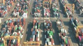 調達 : Aerial hyperlapse of a busy seaport container yard