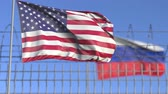 separation : Waving flags of the USA and Russia separated by barbed wire fence. Conflict related loopable conceptual 3D animation