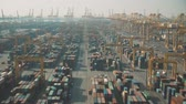 調達 : Low altitude aerial view of a container terminal in port of Dubai, United Arab Emirates