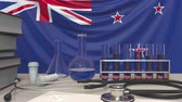 nieuw zeeland : Clinic laboratory equipment on flag background. Healthcare and medical research in New Zealand related conceptual animation