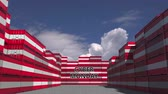 manuseio : Cargo containers with CYBER MONDAY text and national flags of Austria. Austrian online commerce related 3D animation