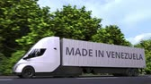 venezuela : Modern electric semi-trailer truck with MADE IN VENEZUELA text on the side. Venezuelan import or export related loopable 3D animation Stock Footage