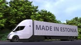 estonya : Modern electric semi-trailer truck with MADE IN ESTONIA text on the side. Estonian import or export related loopable 3D animation