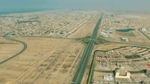 사치 : 360 degree panoramic aerial view of Dubai cityscape and surrounding desert as seen from Jumeirah Village Circle area. UAE