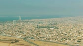 побережье : Aerial view of Al Barsha districts area and distant World Islands in Dubai, UAE