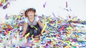 ribbon : Cheerful little girl playing with colorful ribbons at childrens party