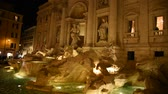 View of the famous Trevi fountain in Rome at night. Стоковые видеозаписи
