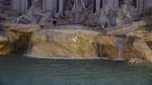 View of the famous Trevi fountain in Rome at night Стоковые видеозаписи