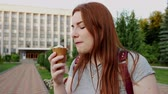 creme : Redhead girl eats and enjoy delicious ice cream