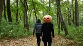 Halloween A pumpkin-headed man gets in the woods. He pulls out a knife and runs after the victim.