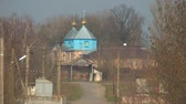 православный : Old wooden church stands at the entrance to the village