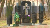 kurban : Small bell on the monument to victims of famine in Ukraine in 1933 Stok Video