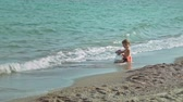 summer : A little angel is playing in the sea water. Spanish beaches in Mallorca
