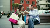 shopping bag sale : Young happy couple meet in the city after shopping