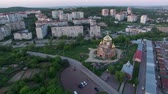lviv : Aerial view of constructed church in Lviv, Ukraine. Aerial shot flying out-around church. Spring sunset.