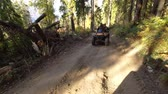 iszapos : Tracking Action Shot of Quad Bike going up on forest road. 4K