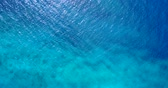 relaxation : v11081 water texture breaking and crashing with drone aerial flying view of aqua blue and green clear sea ocean