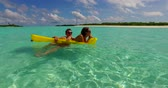 sensual : 2 people inflatable sunbed romantic young people couple with drone aerial flying view on a tropical island of white sand beach and blue sky and sea
