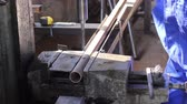 millsime : Male in gloves drills holes in steel girder bar at factory Stock Footage