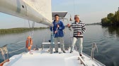 vztahy : Two male sailors on deck of sailing yacht, friends, vacation