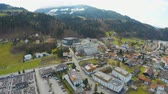 swarovski : Aerial view of Swarovski factory in big modern city at mountain bottom, Wattens