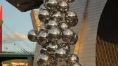 exhibits : Tall Tree and the Eye outside Guggenheim Museum, sculpture of steel spheres Stock Footage