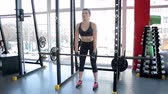 thoroughly : Muscular female athlete doing Romanian deadlift exercise with heavy barbell