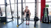 thoroughly : Strong woman doing barbell exercise, female bodybuilder training before contest Stock Footage