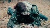 zombi : Injured male wearing military uniform crawling, zombie escaping from underworld