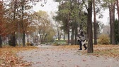 madman : Tall man covered with blanket limping in park, mental disorder, homelessness Stock Footage