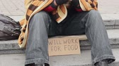 pieski : Man in park with ready to work for food sign, homeless begging, poverty, sadness