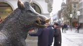 must see : Bronze statue of wild boar in historical city center, tourists walking around