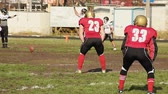 gridiron : Football player kicking ball off to opposing team after scoring points in match Stock Footage