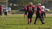 замена : Active American football players changing field sides during game, amateur match