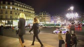 életmód : Urban life, people walking across illuminated square, city traffic in the street
