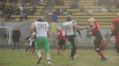 gridiron : Gridiron football player making forward pass towards defensive teams goal line