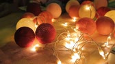 papier : Female hands assembling garland from handmade glowing balls, festive atmosphere Stock Footage