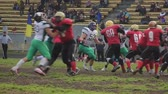 gridiron : Active football players fighting for ball on field, competing to win match