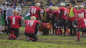 gridiron : Medics taking injured football player from field on stretcher, render first aid Stock Footage