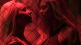 promiscuous : Two beautiful women dancing and talking at night club, sexual desire, passion