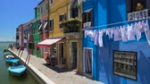 season : Nice brightly colored houses on Burano island, Italian place of tourist interest